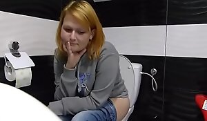 woman poop in toilet