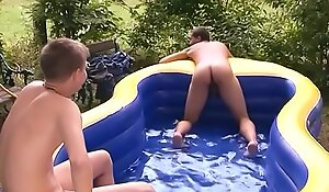young boys playing just about the garden