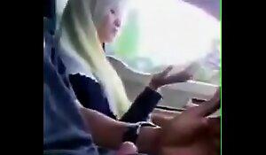 Malay girl giving handjob while driving